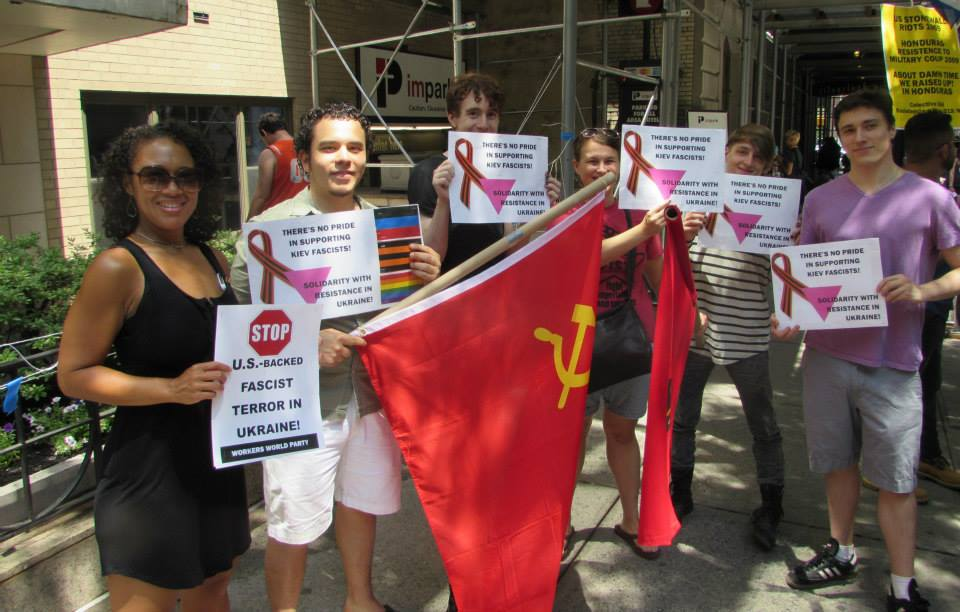 Members of the LGBTQ community at Pride Parade in NY carrying fascist homophobe symbols.
