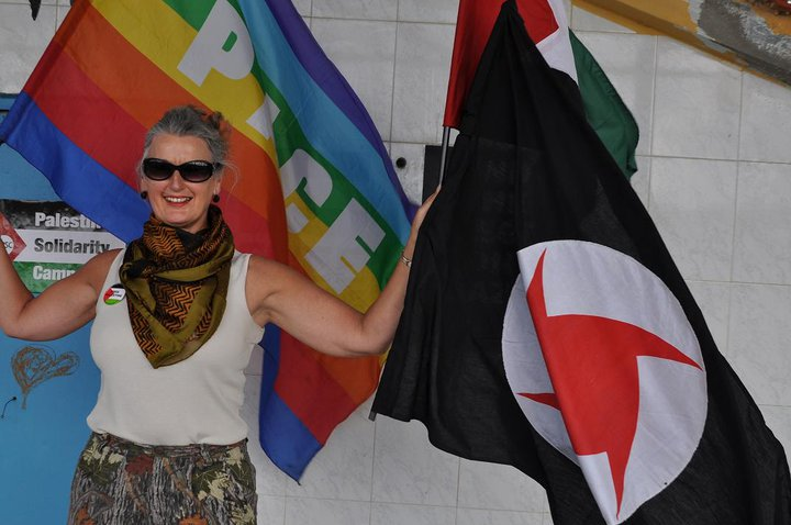 Pippa proudly posing with the Syrian fascist flag from SSNP.